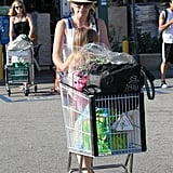 Busy Philipps pushed Birdie and a cart full of goodies from Whole Foods.