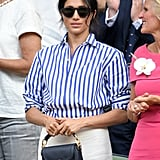 When Meghan attended the Wimbledon tennis championships in London in July 2018, she coordinated a striped Ralph Lauren shirt with chic white pants from the label, toting her Altuzarra bag.