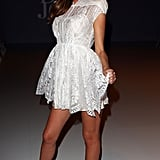 Miranda Kerr in a little white dress.