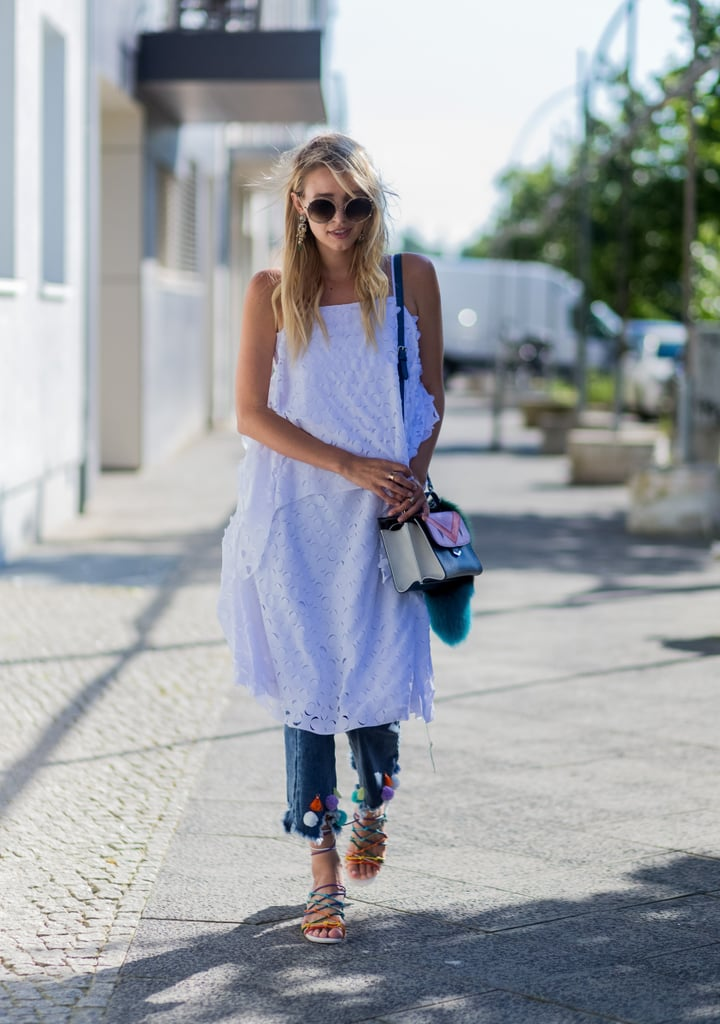 A White Dress Worn Over Jeans