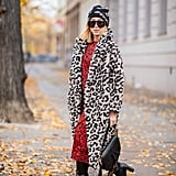 Wear an eye-catching, cherry red dress underneath a coat in a coordinating print, and leave the buttons undone.