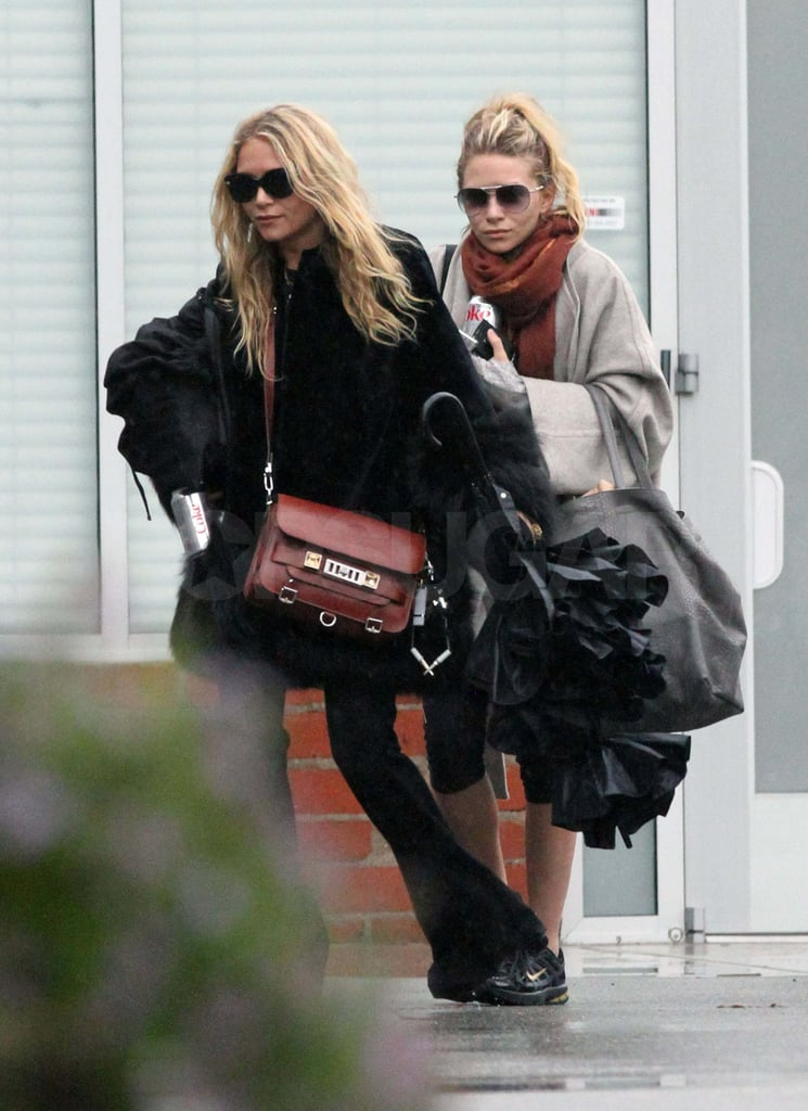Mary-Kate and Ashley Olsen were layered up for a busy afternoon at a studio in Culver City, CA, yesterday. The duo are back to work after Ashley escaped to St. Barts for a bikini getaway with Justin Bartha last week. She and Justin are one of the most adorable couples of the year and perhaps the rumored to be engaged duo will soon show up on the list of celebrity newlyweds. When Ashley didn't have Justin by her side, she shared her big year with her sister, both on red carpets and prepping their line for the runways.
