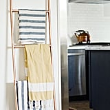 Don't hang a towel rack — lean a ladder.