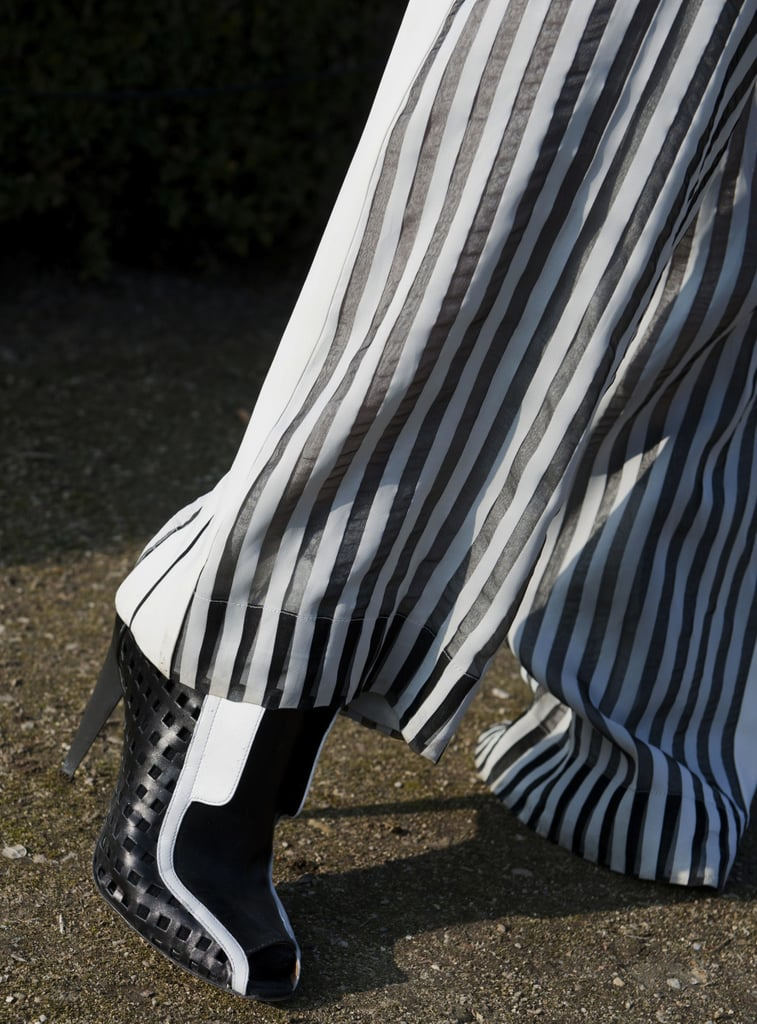 We love how these black-and-white colorblocked ankle boots elevated a pair of striped trousers.