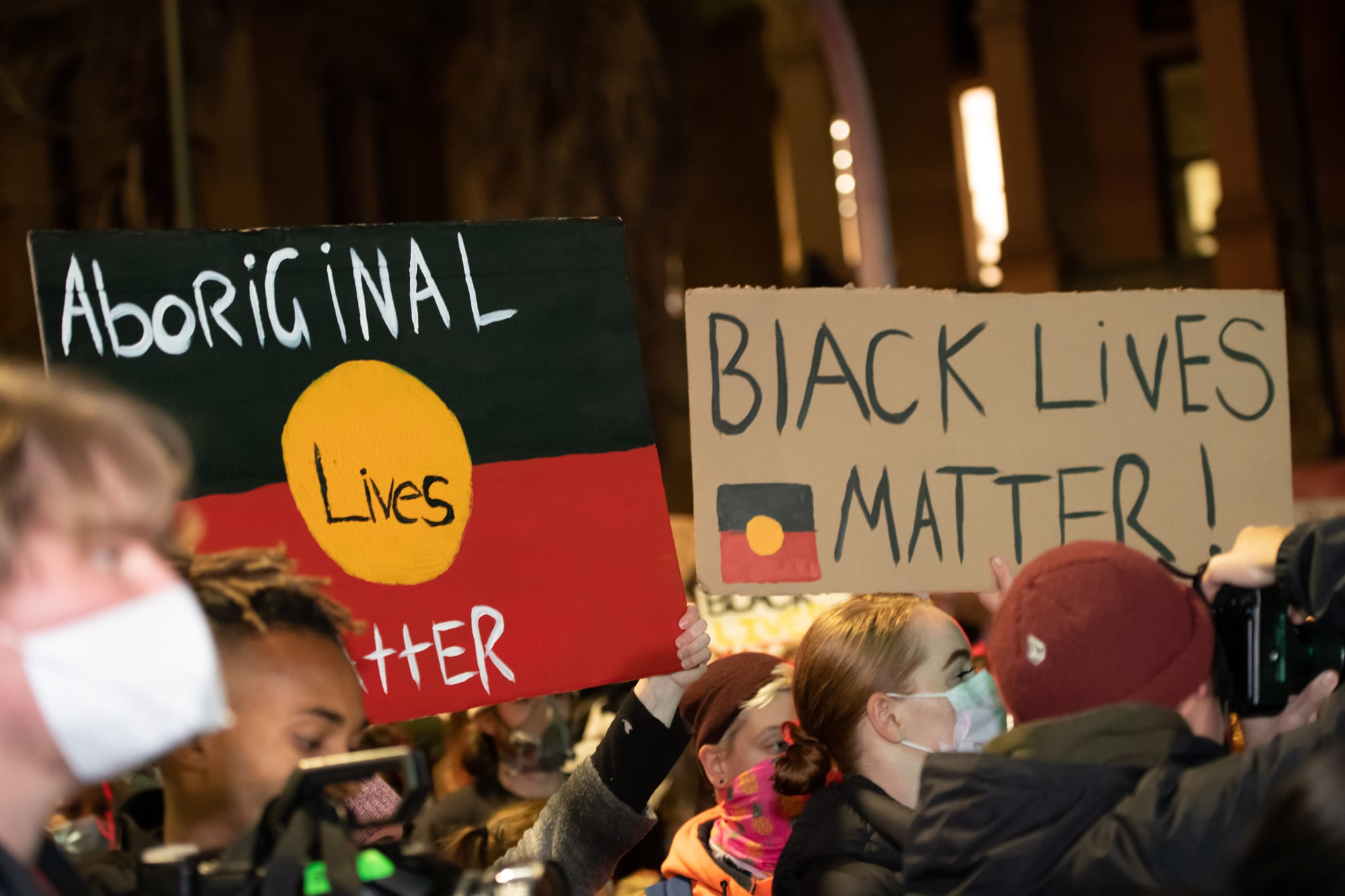 Protestors wearing masks in Martin Place during a ''Black Lives Matter'' rally, held in solidarity with U.S. Protests over the death of George Floyd on June 02, 2020 in Sydney, Australia. The event was organised to rally against aboriginal deaths in custody in Australia as well as in solidarity with protests across the United States following the killing of an unarmed black man George Floyd at the hands of a police officer in Minneapolis, Minnesota. (Photo by Izhar Khan/NurPhoto via Getty Images)