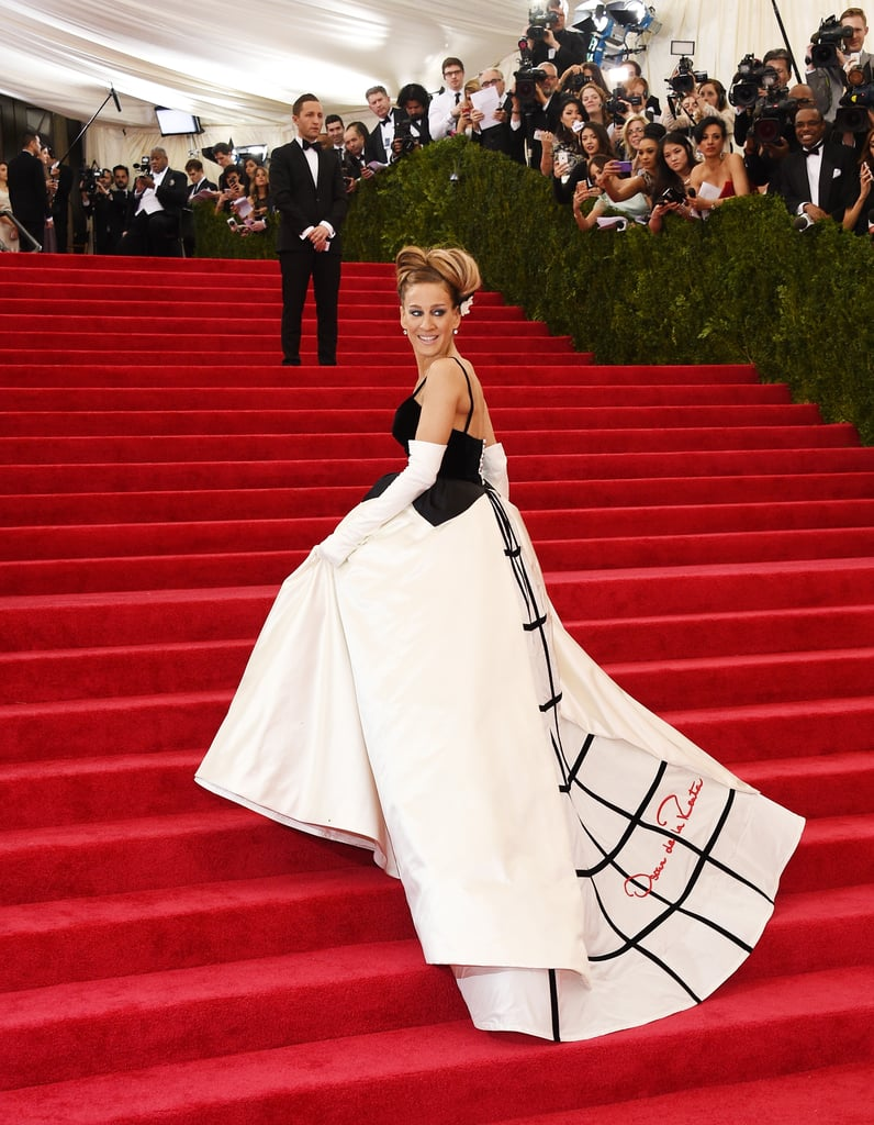 Sarah Jessica Parker dropped jaws as she hit the red carpet at today's Costume Institute Gala at the Metropolitan Museum of Art in NYC. The actress posed for photographers in an Oscar de la Renta gown and was all smiles while posing with her date for the night, Andy Cohen. Not only is Sarah Jessica a true Met Gala veteran — she has attended the event five times — but she's also a trusted co-chair of the event, along with Anna Wintour, Oscar de la Renta and Bradley Cooper. See all the photos from SJP's high-fashion night at the Met Gala!
