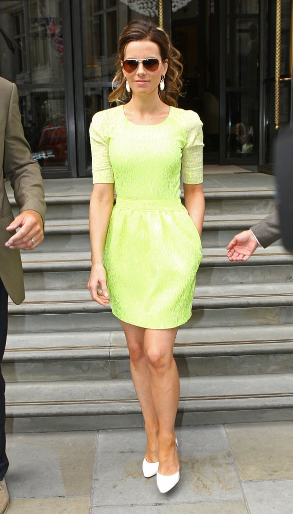 A bolder ensemble Kate wore in London was a neon lace Preen dress with white pumps, white drop earrings, and aviator sunglasses.