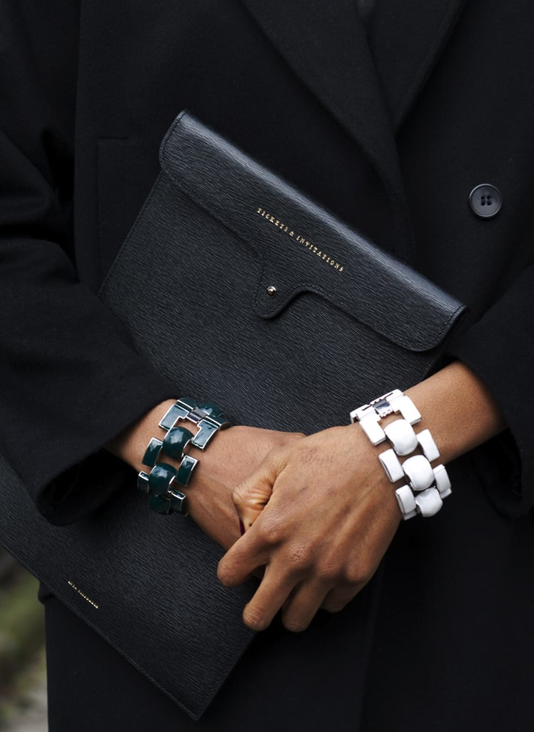 Black-and-white chain-link bracelets popped against an all-black outfit.