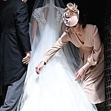 Kate returned the favor by helping straighten Pippa's veil at her wedding in May 2017.