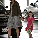 Suri Cruise had a purse in one hand and Katie Holmes's hand in the other.