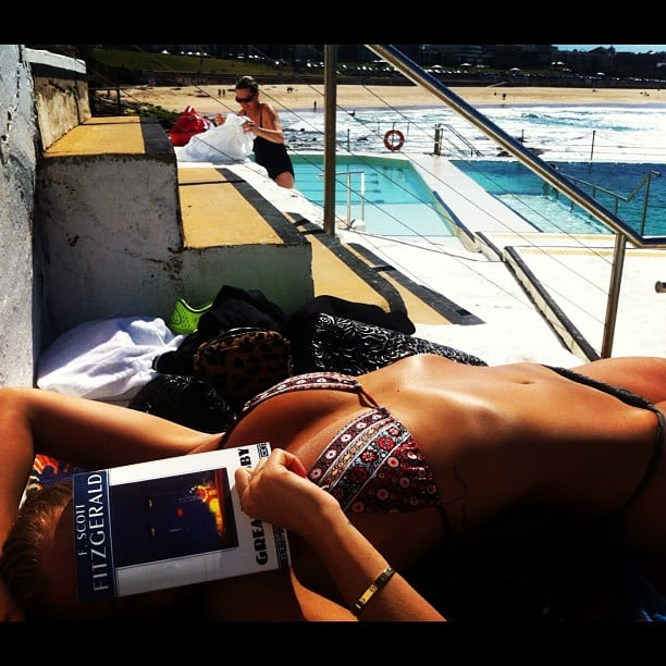 Lara Bingle caught up on a classic novel as she lay poolside at Bondi. Source: Instagram user mslbingle