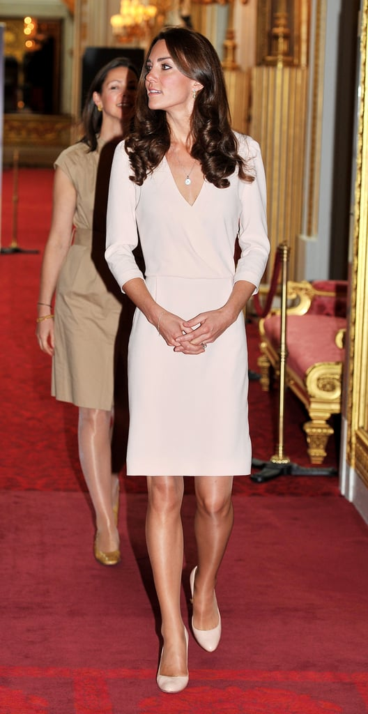 Kate was the picture of cream perfection in a Joseph sheath and Jimmy Choo pumps as she viewed the exhibitions for the Summer opening of Buckingham Palace in July 2011.