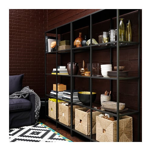 This metal and glass shelf ($89.99) showcases treasures, artwork, and stacks of books beautifully, all while letting natural light shine through. Two units placed side to side (as shown here) are a great way to fill a large wall.
