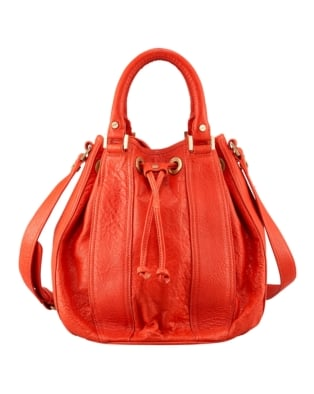 This Tory Burch Bucket Bag ($450) is the perfect shade of orange-red.