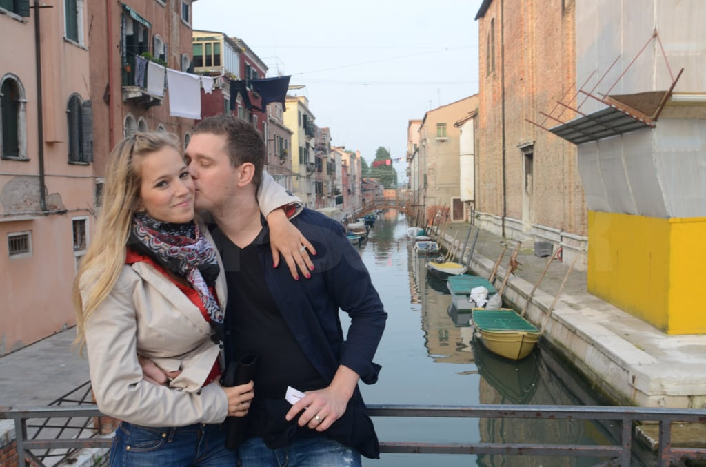 Michael Bublé married Luisana Lopilato nearly a month ago in her home city of Buenos Aires, and the duo are now off in Italy on their honeymoon! The newlyweds spent the Easter holiday together in Venice, and they were spotted smiling to photographers while enjoying a water taxi ride and exploring the city on foot. Their first legal ceremony was quickly followed up with a larger, friend- and family-filled celebration in the Argentine countryside. Their nuptials were well publicized and, unfortunately, thieves took advantage of their absence from Buenos Aires immediately after the wedding to rob their apartment. Michael and Luisana didn't seem to be dwelling on their missing items yesterday, as they kissed their way around the city.