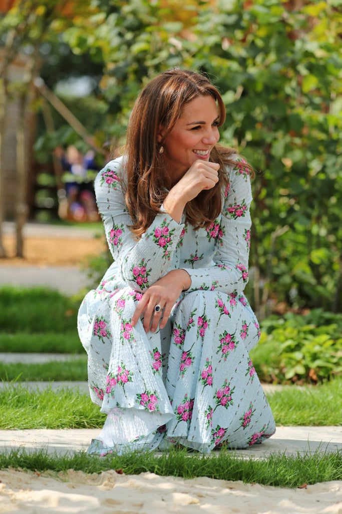 Kate Middleton clung to the last days of Summer one more time on Tuesday when she attended RHS Garden Wisley to unveil the latest iteration of her Back to Nature Garden. The duchess joined food writer, TV presenter, and British national treasure Mary Berry at the event, with both of them opting for floral looks that were perfectly in keeping with the surroundings. Kate's dress came from one of her go-to designers, Emilia Wickstead, whom she's turned to time and time again since joining the royal family. This time around, she picked the designer's Aurora dress, which is another shirtdress — a silhouette that's quickly becoming her new trademark — in a blue and pink floral print, with patch pockets on the bust and a matching fabric belt. She teamed the pretty design with beige wedge sandals and eschewed her usual clutch bag (or at least handed it to a member of staff), so she could play with the children at the event. Kate's dress is still available to buy, so keep reading for a closer look and your chance to snap up a little royal style. Related: Kate Middleton's School Drop-Off Dress Proves That Summer Isn't Over Just Yet