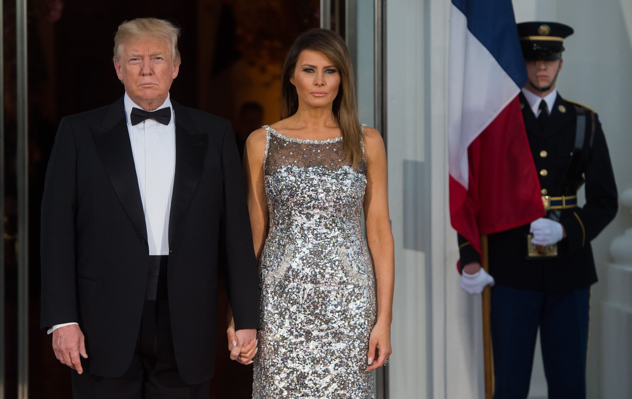 TOPSHOT - US President Donald Trump and First Lady Melania Trump welcome French President Emmanuel Macron and his wife Brigitte Macron as they arrive for a State Dinner at the North Portico of the White House in Washington, DC, April 24, 2018. (Photo by SAUL LOEB / AFP)        (Photo credit should read SAUL LOEB/AFP/Getty Images)
