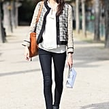 A tweed cardi added all the right styling notes to a pair of basic black pants and boots.