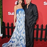 Amal attended the LA premiere of Suburbicon with George Clooney in 2017. She wore a Bill Blass gown and accessorized with Lorraine Schwartz earrings and a metallic Judith Leiber clutch.