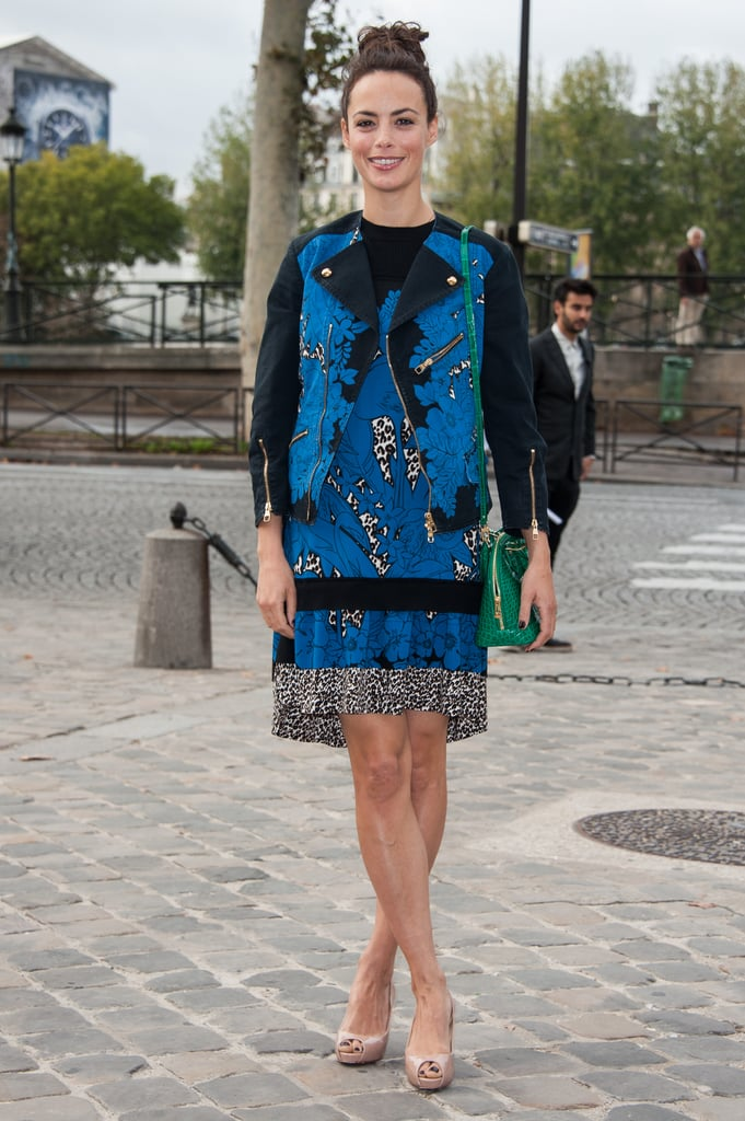 Bérénice Bejo wore a matching printed jacket and shiftdress combo, pairing a bright green purse for an extra pop of dynamic, for Louis Vuitton.