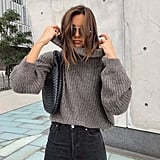 A Gray Turtleneck Sweater, Dark Skinny Jeans, and a Black Shoulder Bag