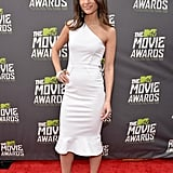 Jordana Brewster had an all-out white moment in a one-shouldered dress with a ruffle hem, Casadei's Blade pumps, and a couple bangles at the MTV Movie Awards.