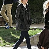 Emma Stone rocked a tweed and leather moto-style coat by Majoe while strolling through Paris.