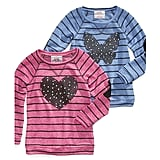 Choose from a heart or butterfly design — either way, she'll want to wear this graphic shirt ($26) at home or at play.