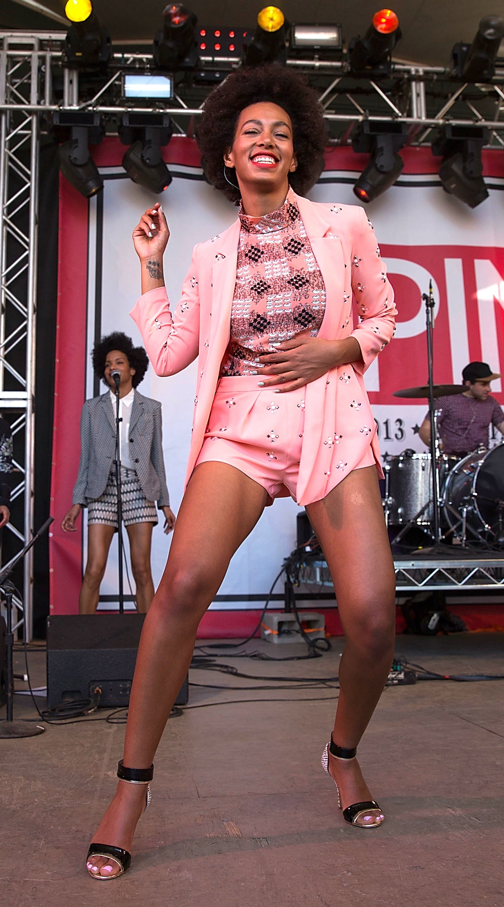 Solange Knowles suited up in a pastel-pink Clover Canyon duo, printed Marni top, and minimalistic Nicholas Kirkwood sandals while on stage in Austin.