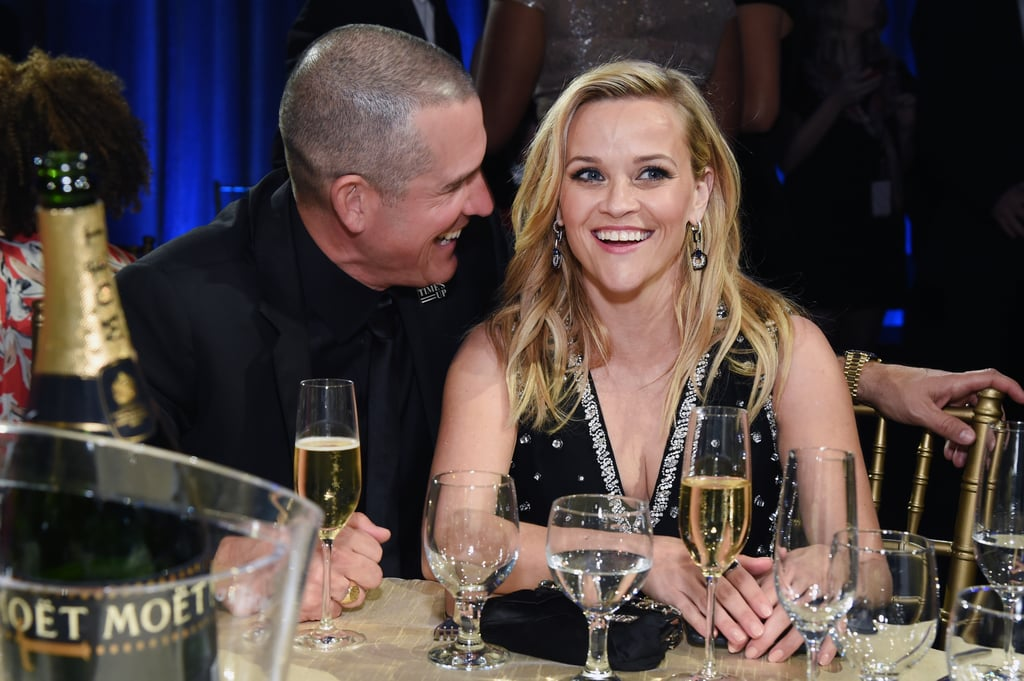 Reese Witherspoon attended the Critics' Choice Awards with her husband, Jim Toth, and the two were caught sitting at their table looking smitten. Jim was clapping alongside his wife, posing for photos, and convincing us they are one smoking-hot couple. We especially love the photo of Jim laughing into Reese's ear while she smiles from ear to ear. The couple tied the knot in 2011 and seem to be having a blast together. Keep scrolling to see the proof.      Related:                                                                                                           12 Times Reese Witherspoon Is F*cking Hilarious in Big Little Lies