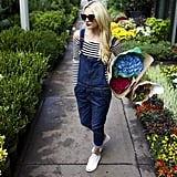 Denim Overalls, a Striped Off-the-Shoulder Top, and White Low-Tops