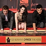 Kristen Stewart, Robert Pattinson, and Taylor Lautner pressed their hand prints into the wet cement.