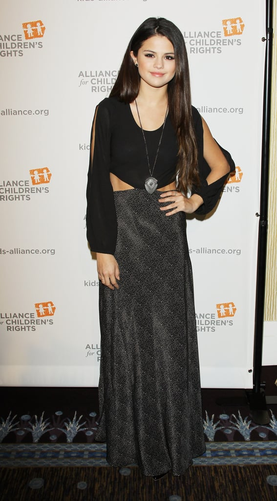 At The Alliance For Children's Rights annual dinner in Beverly Hills, Selena Gomez donned this Lovers & Friends cutout maxi dress ($150, originally $215) with a long silver shield necklace.