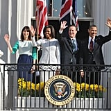 The Obamas wave with the prime minister and his wife.