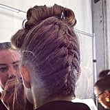 At Badgley Mischka, braided updos were inspired by Hitchcockian beauties.