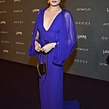 Florence Welch opted for a brilliant custom cobalt Gucci gown with dramatic sheer sleeves and a gold headpiece to finish it off.