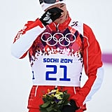 Gold medalist Dario Cologna of Switzerland teared up during the flower ceremony for the men's 30km skiathlon event.