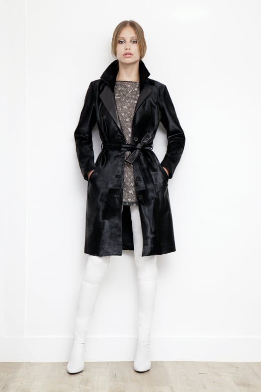Long Sleeve Lace Window Print Silk Blouse in Black, Calf Hair Trench Coat in Black, Sweet Revenge Stretch Nappa Legging Boot in Cream. Photo courtesy of Tamara Mellon