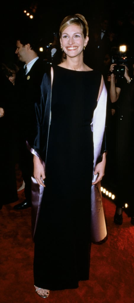 Julia Roberts walked the red carpet wearing a black sheath dress in 1998.