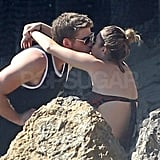 Liam kissed Miley by the rocks.