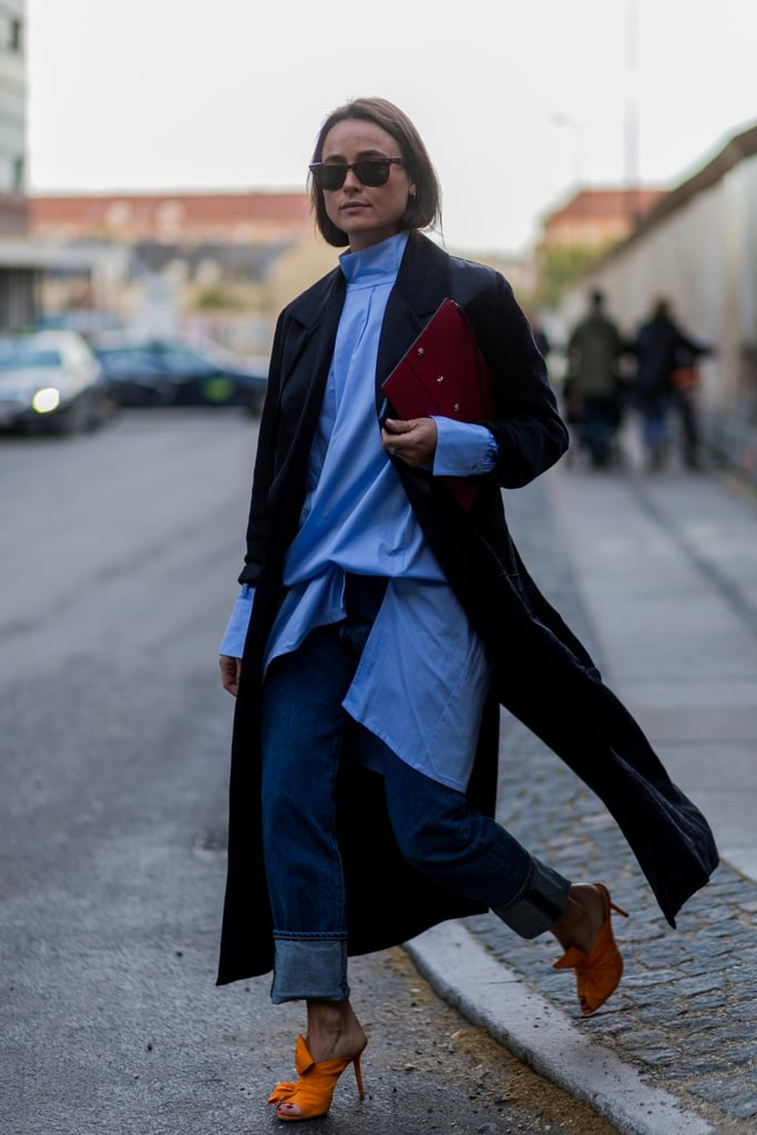 With an oversize blouse and rolled up to show off your heels