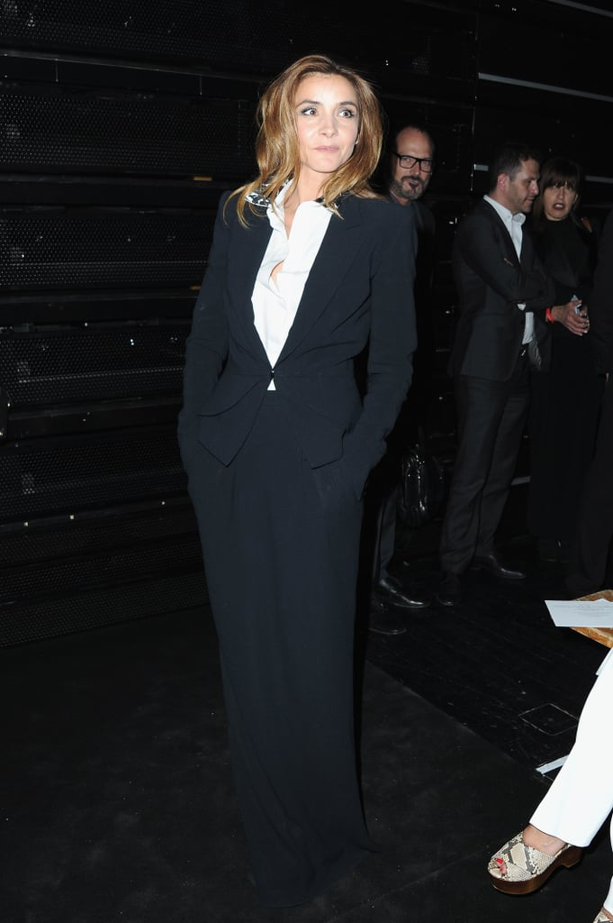 Clotilde Courau matched the black color palette at Viktor & Rolf's Haute Couture show.