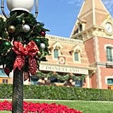 Guests are greeted at Disneyland Main Street Train Station with a hint of the holiday cheer to come upon entering the park.