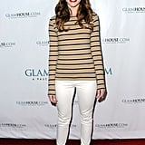 Revenge's Christa B. Allen dressed up jeans and a striped tee with strappy burgundy heels.