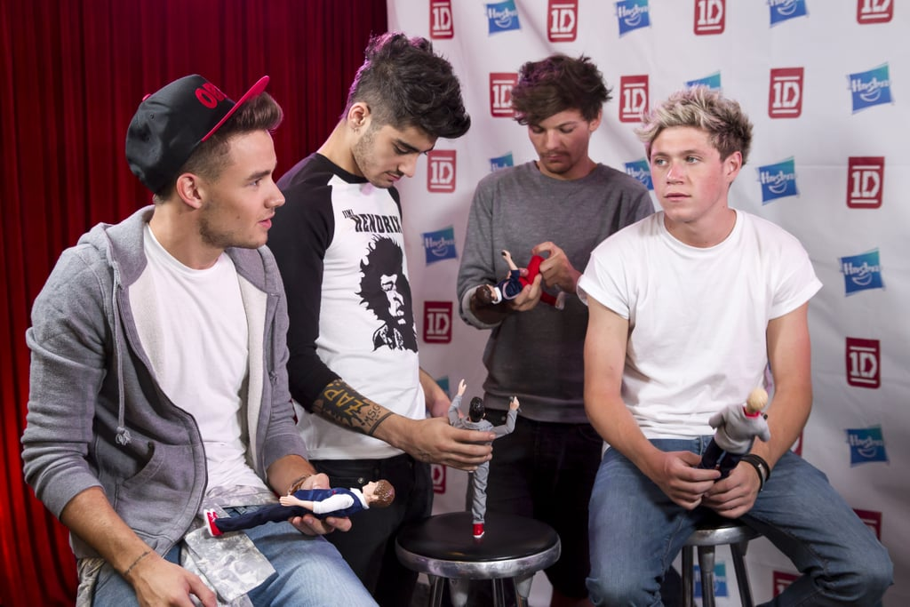 One Direction With Their One Direction Dolls in LA in 2013