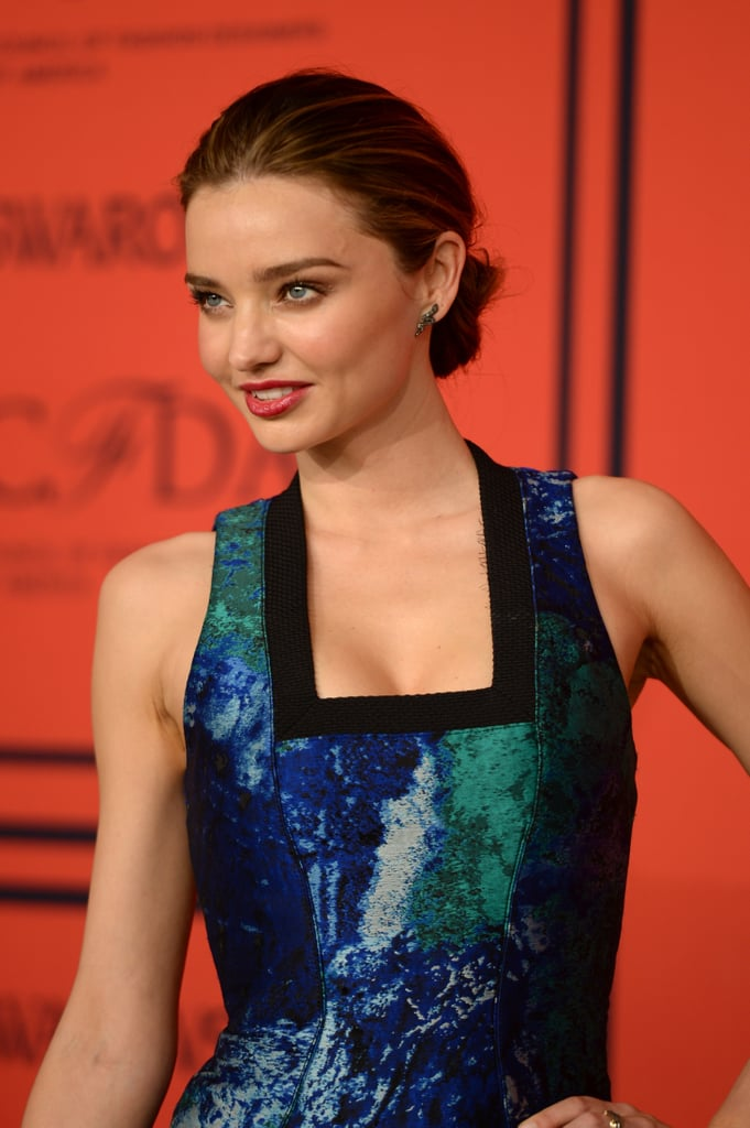 Miranda Kerr's low-slung bun and red lips.