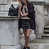 It doesn't take a lot, but a little plaid and leather gave this street style moment some punk appeal.