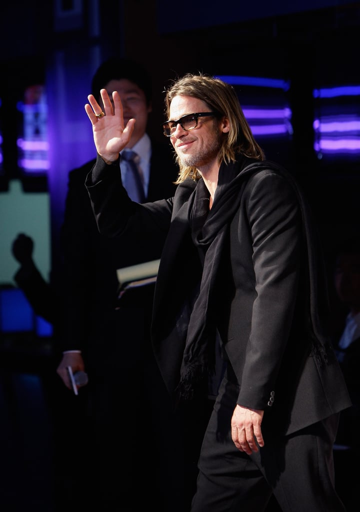 Brad Pitt stepped out in all black at the Seoul premiere of Moneyball this evening after giving a press conference earlier in the day. The actor, who stopped to pose for pictures with fans and sign autographs just before the screening, arrived solo after bringing Angelina Jolie along for several of his recent red carpet appearances. She was by his side at the Tokyo debut of the film earlier this month. They brought all six of their kids along for the trip and the Jolie-Pitts visited Vietnam after wrapping up their stay in Japan. Their son Pax was born there and the family reportedly paid a visit to the orphanage where he once lived during their visit. Brad and Angelina spend much of their time traveling for their various work and philanthropic obligations, and Brad recently hinted that he might be interested in a more behind-the-scenes role in the movies —and more kids —in the coming years. Brad said he may quit acting at age 50 during a recent interview and also didn't rule out the possibility that he and Angie might expand their family.