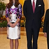 We can't get enough of this! Kate Middleton chose a purple-and-cream Rorschach floral-printed dress by Prabal Gurung as part of their Diamond Jubilee tour in Asia. To finish the look, she wore black Prada pumps and toted a black clutch.