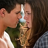 After punching Jacob the first time he tried to kiss her, Bella begs him to kiss her toward the end of Eclipse. Jacob does, but when her vampire fiancé finds out, Bella tells Edward she loves him, not Jacob, more.